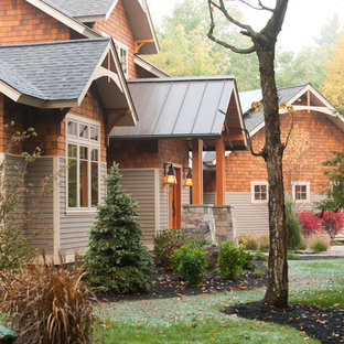 Inspiration for a huge craftsman multicolored two-story mixed siding gable roof remodel in New York