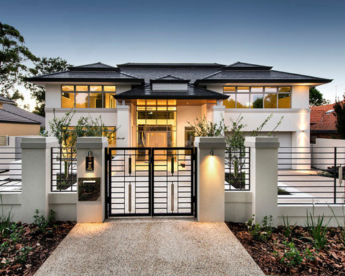 Trendy white two-story exterior home photo in Perth
