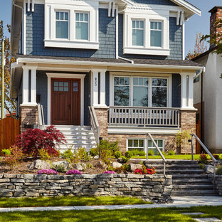 Craftsman blue three-story gable roof idea in Vancouver