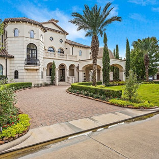 Mediterranean two-storey beige house exterior in Houston with a tile roof.