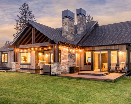 inspiration for a large rustic brown one story wood gable roof remodel in other with