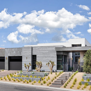 Inspiration for a contemporary gray one-story concrete exterior home remodel in Las Vegas