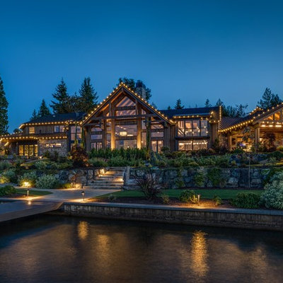 Mountain style brown one-story wood exterior home photo in Seattle