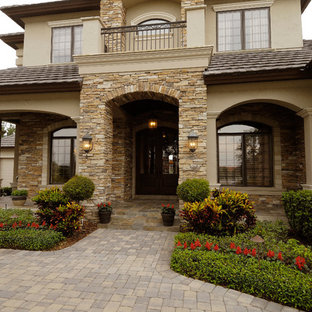 Inspiration for a large mediterranean exterior home remodel in Tampa