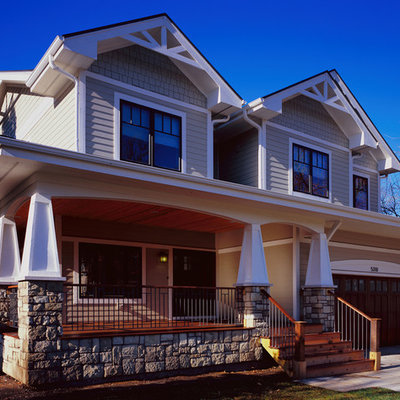 Inspiration for a mid-sized craftsman beige two-story mixed siding house exterior remodel in Chicago with a shingle roof