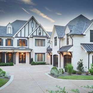 Inspiration for a huge victorian white three-story stone exterior home remodel in Nashville