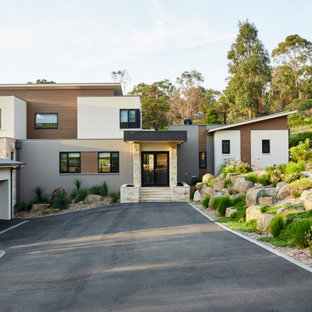 Inspiration for a contemporary two-storey multi-coloured house exterior in Melbourne with mixed siding and a shed roof.