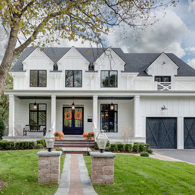 Inspiration for a large farmhouse white two-story wood house exterior remodel in Chicago with a shingle roof
