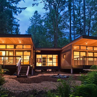 Example of a mid-sized mountain style brown one-story wood exterior home design in Seattle with a shed roof