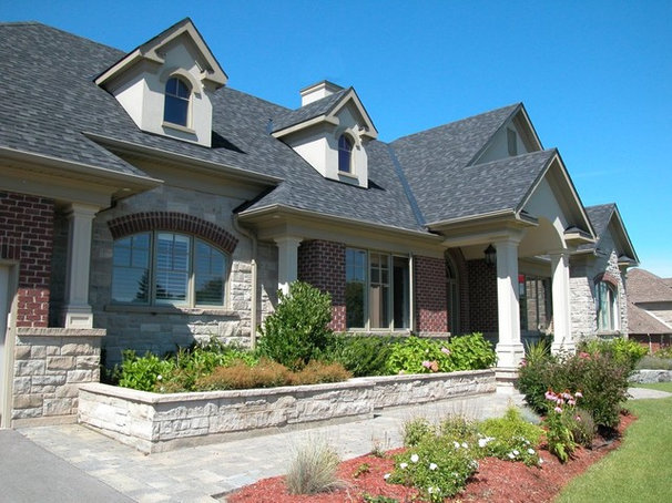 Traditional Exterior by New Age Design