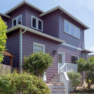 Inspiration for a large craftsman purple two-story wood exterior home remodel in Seattle with a hip roof