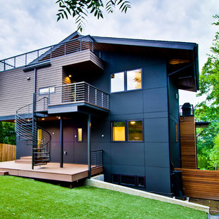 Inspiration for a large modern green three-story wood exterior home remodel in Seattle
