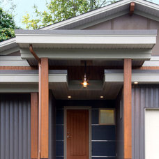 Contemporary Exterior by Capstone Dwellings, Design-Build