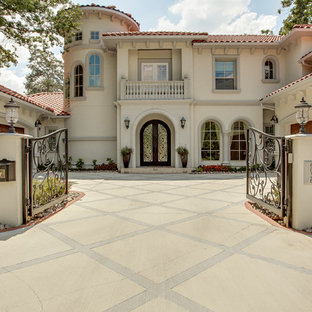 Beige mediterranean two floor exterior in Dallas.