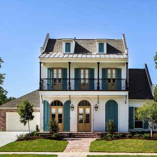 Design ideas for a large traditional two-storey white exterior in New Orleans with mixed siding.