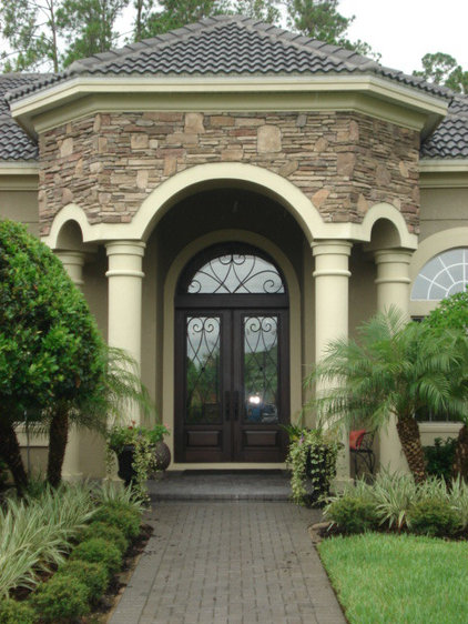 Mediterranean Exterior by Brentwood Construction and Remodeling