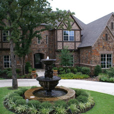 Traditional Exterior by DeCavitte Properties