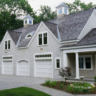 Large traditional gray two-story wood exterior home idea in Portland Maine with a gambrel roof