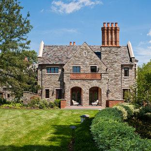Huge traditional gray stone exterior home idea in Philadelphia