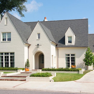Design ideas for a large classic two floor brick exterior in New Orleans with a pitched roof.