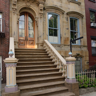 Inspiration for a huge timeless three-story townhouse exterior remodel in New York