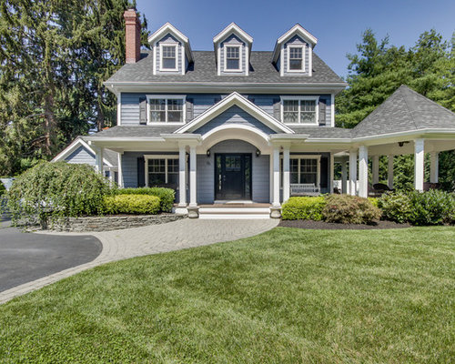 elegant blue two story gable roof photo in new york with a shingle roof