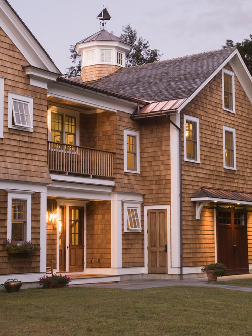 Large Traditional Beige Two Story Wood Exterior Home Idea In Burlington  With A Shingle Roof