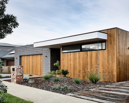 Design Ideas For A Contemporary One Storey Exterior In Other With Mixed  Siding And A