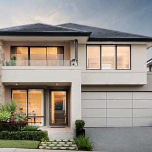 Inspiration for a contemporary two-storey stucco beige house exterior in Perth with a hip roof.