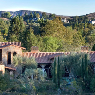 Example of a tuscan exterior home design in Orange County