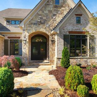 Elegant beige two-story stone exterior home photo in Atlanta