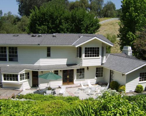 Foto e idee per facciate di case facciata di una casa in for Piani di case modulari con 2 master suite
