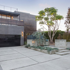 Contemporary Exterior by Shelby Wood Design
