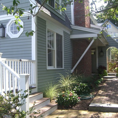 Inspiration for a coastal wood exterior home remodel in Boston