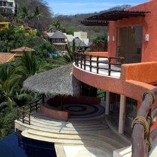 Tropical Exterior by arqflores / architect