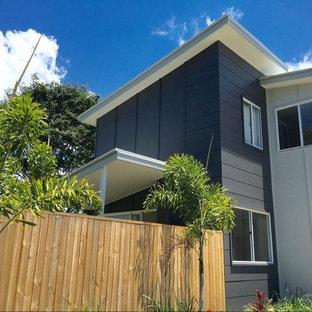 Foto de fachada de casa pareada multicolor, contemporánea, pequeña, de dos plantas, con revestimiento de aglomerado de cemento, tejado plano y tejado de metal