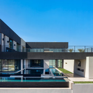 Expansive contemporary house exterior in Las Vegas with three or more storeys.