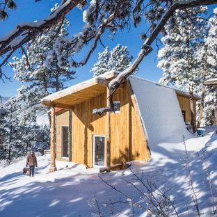 Kleines Rustikales Haus mit Flachdach in Denver