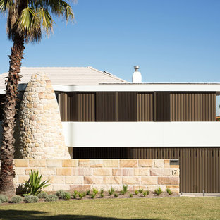 Large two-storey white exterior in Sydney with a flat roof.