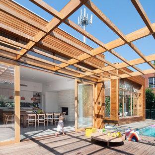 Foto de fachada contemporánea, de tamaño medio, de una planta, con revestimiento de madera y tejado plano