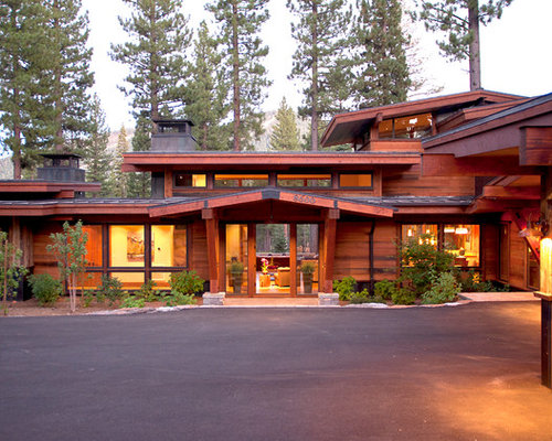 Large Mountain Style Brown Two Story Wood Gable Roof Photo In Sacramento  With A Metal