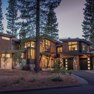 Mountain style brown two-story wood house exterior photo in Sacramento with a shed roof