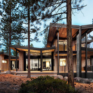 Example of a trendy two-story wood exterior home design in Sacramento