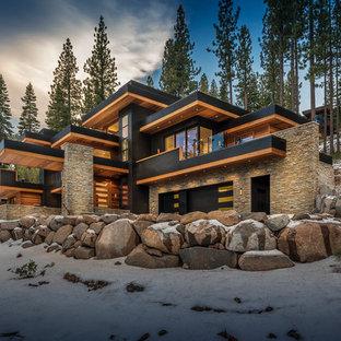Inspiration för stora moderna svarta hus, med tre eller fler plan, blandad fasad och platt tak