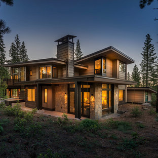 Inspiration for a large rustic brown two-story wood house exterior remodel in Sacramento with a shed roof and a metal roof