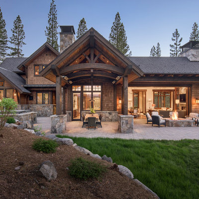 Inspiration for a large rustic brown two-story wood house exterior remodel in Sacramento