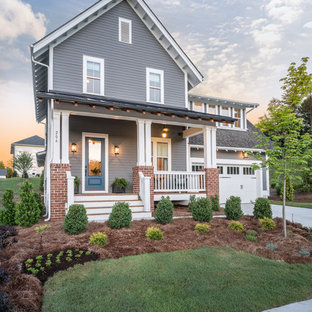 Mid-sized transitional gray two-story wood exterior home idea in Charlotte with a shingle roof