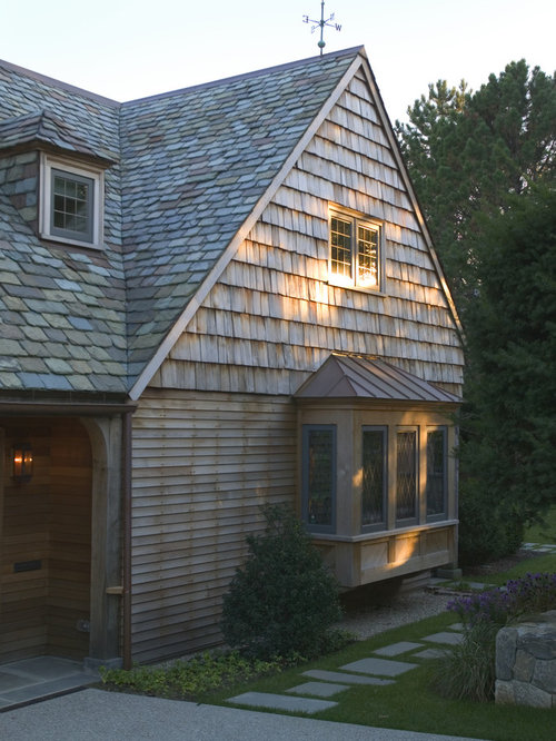 example of a large classic twostory wood gable roof design in boston