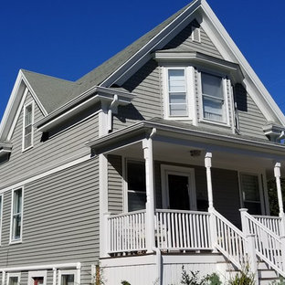 Mid-sized elegant gray two-story vinyl exterior home photo in Boston with a shingle roof
