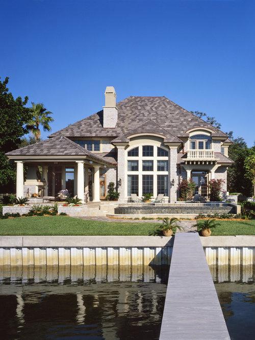 Idee per la facciata di una casa grande beige classica a due piani con with facciata casa in pietra - Facciata casa in pietra ...